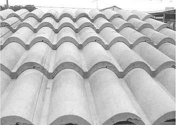 Distribuidor de forma de telha de cimento